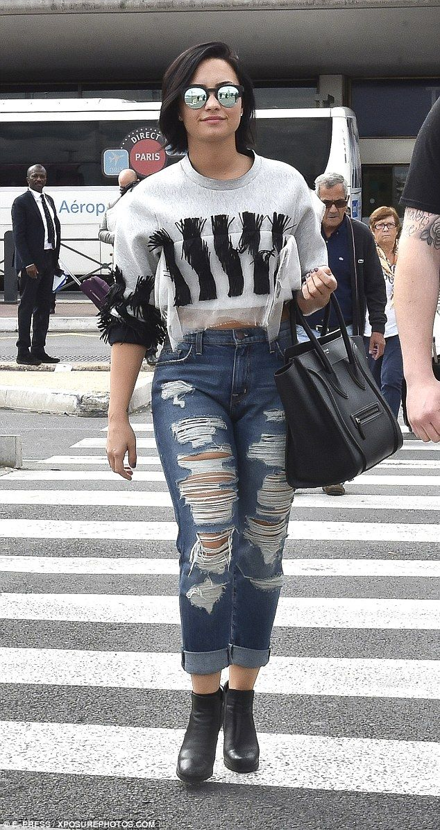 4fc9061c4696f7 Demi Lovato looks in sprightly spirits as she touches down in Paris ...