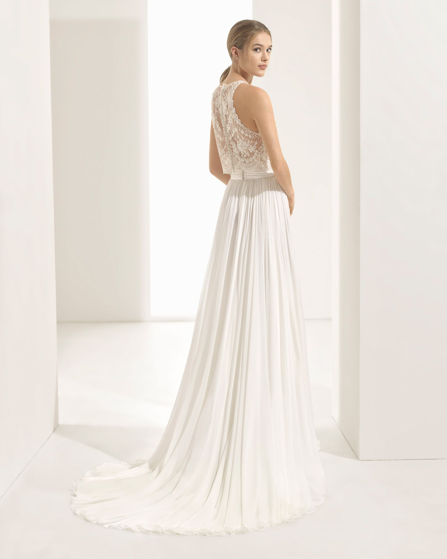 be59bbdf12428 Boho-style beaded lace and voile wedding dress with halter neckline and  sheer inserts, in natural/nude. 2018 Rosa Clará Couture Collection.