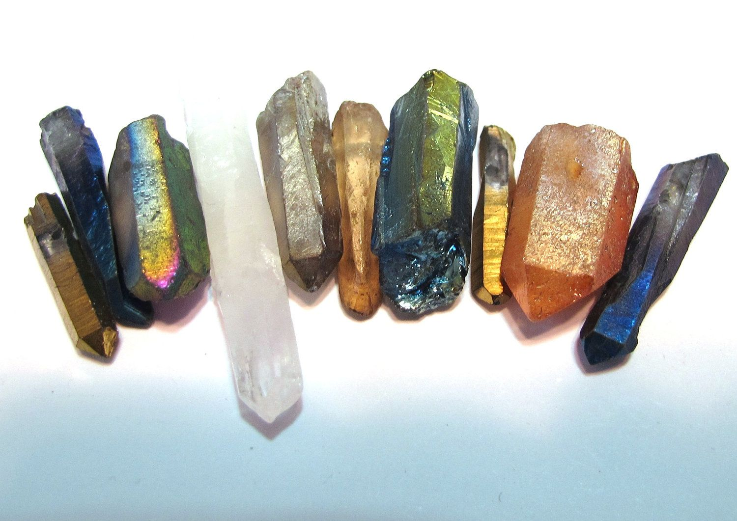 Natural rock crystal points druzy type titanium and mystic coated mixed sampler 10 piece lot. $5.00, via Etsy.