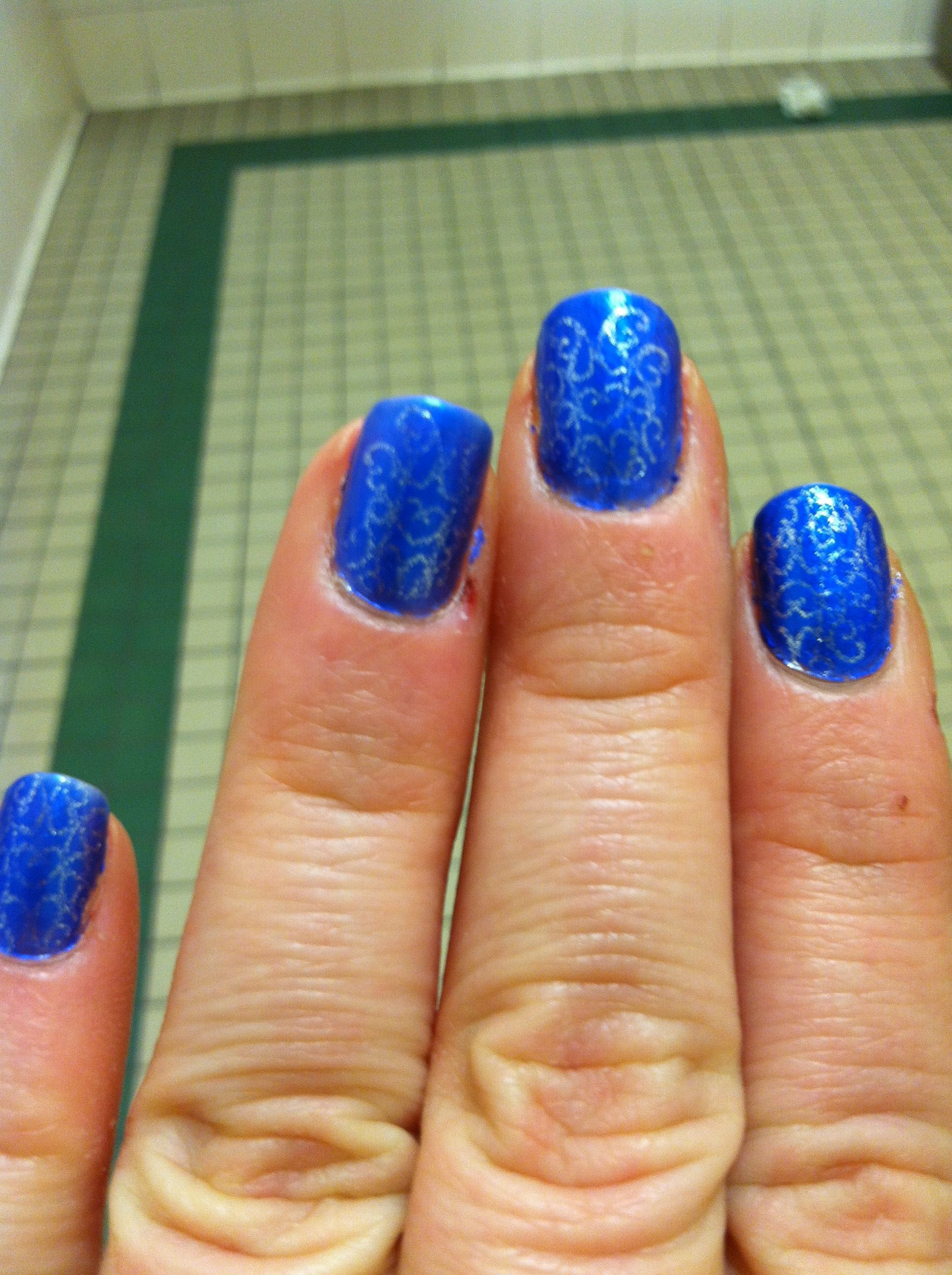 Nail stamping silver on blue