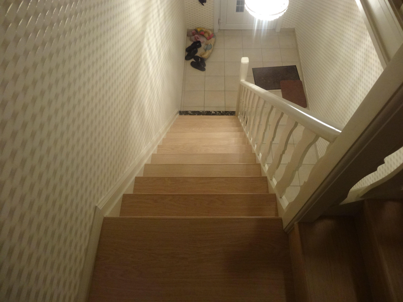 Schrijnwerkerij wybo herbeleggen trap met quickstep laminaat