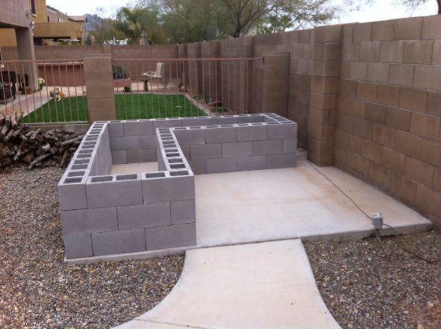 Building a cinder block raised garden yard garden for Cinder block garden designs