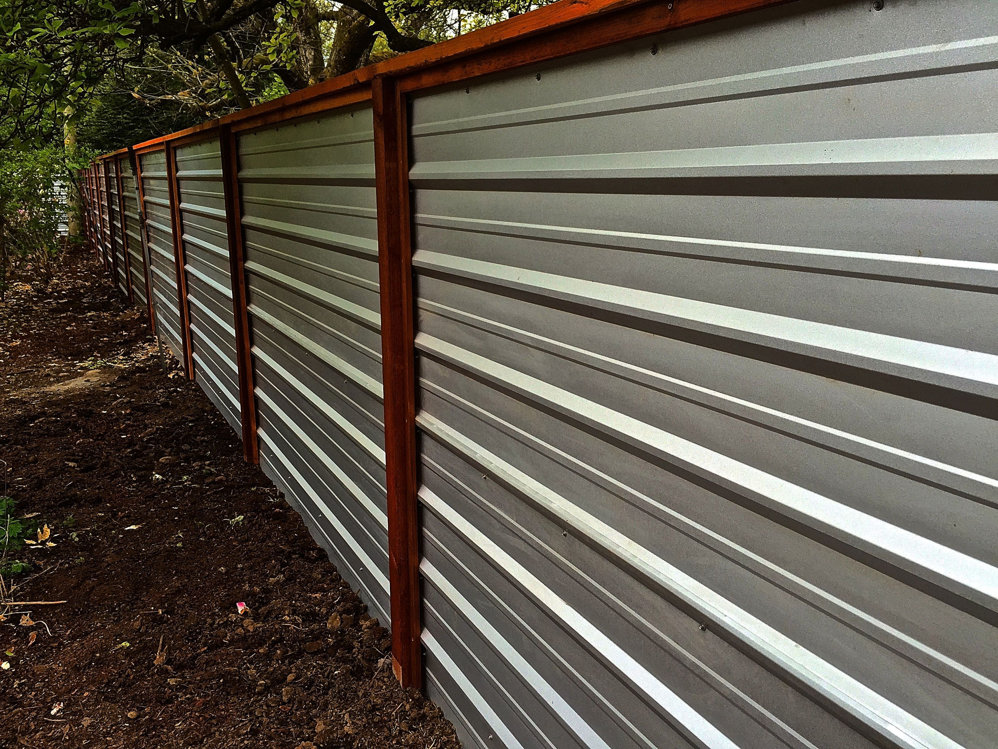 A Galvanized Corrugated Metal Fence Creates A Clean Modern Edge