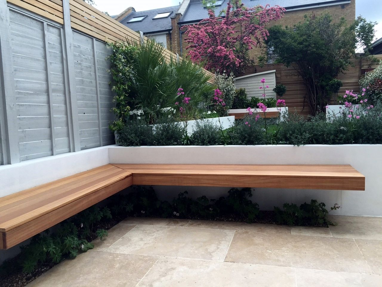 floating hardwood bench travertine paving raised beds brixton