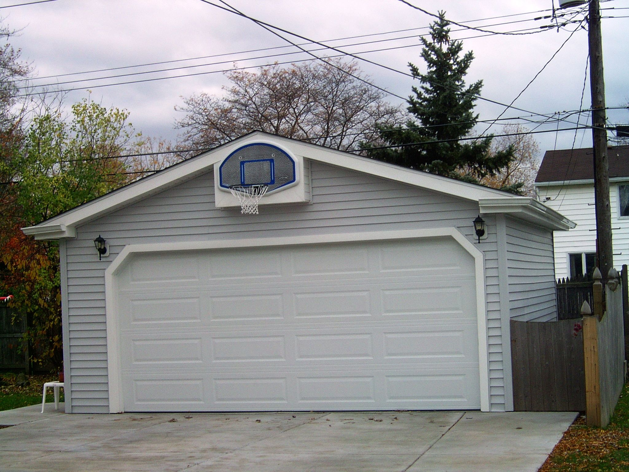 Every driveway needs a basketball hoop garages for Basketball garage