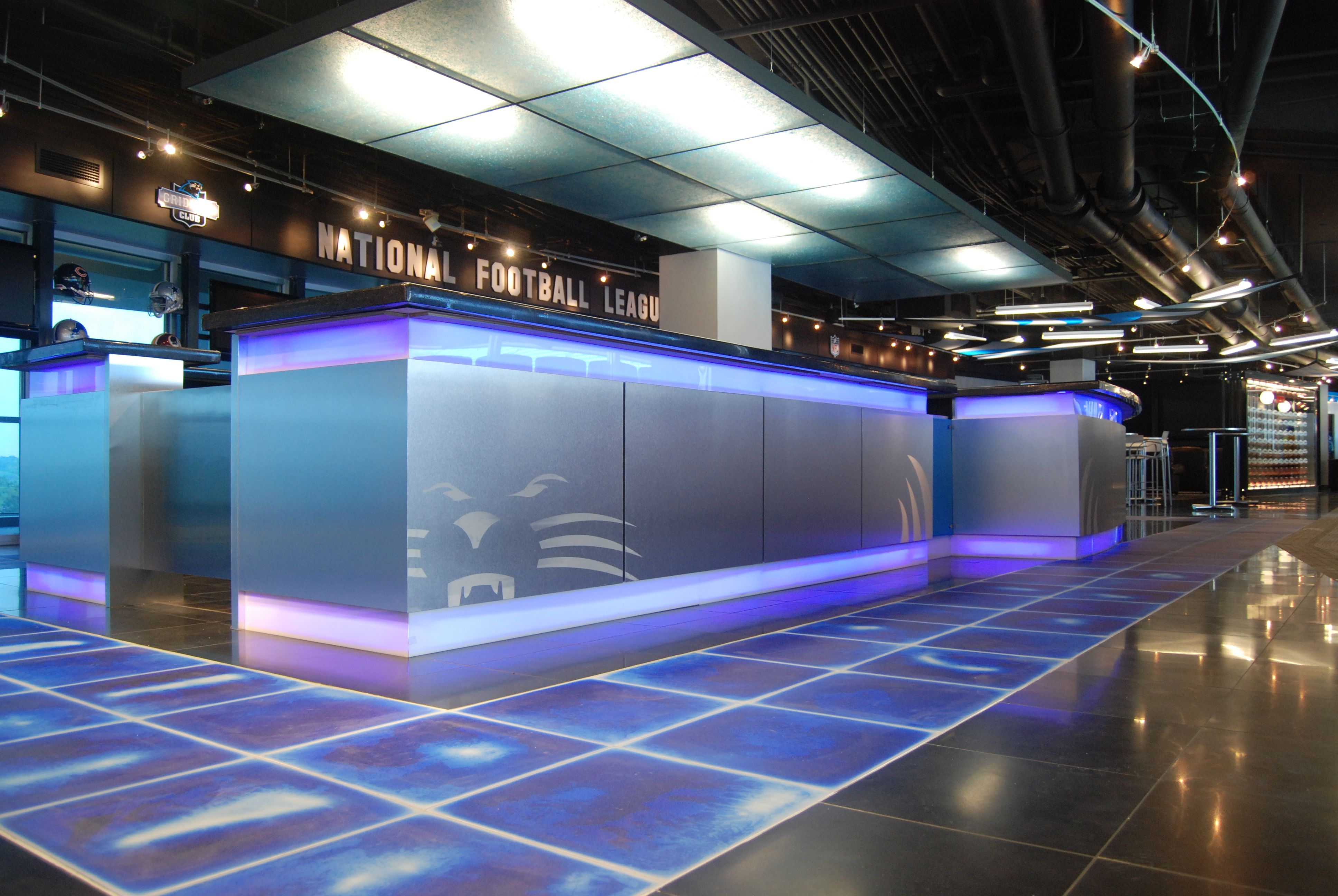 Glass bar reveals every thing nothing hidden away the silver the carolina panthers stadium bank of america grid iron clubsign by wagner murray architects blue liquid floor tiles by cafe interiors dailygadgetfo Choice Image