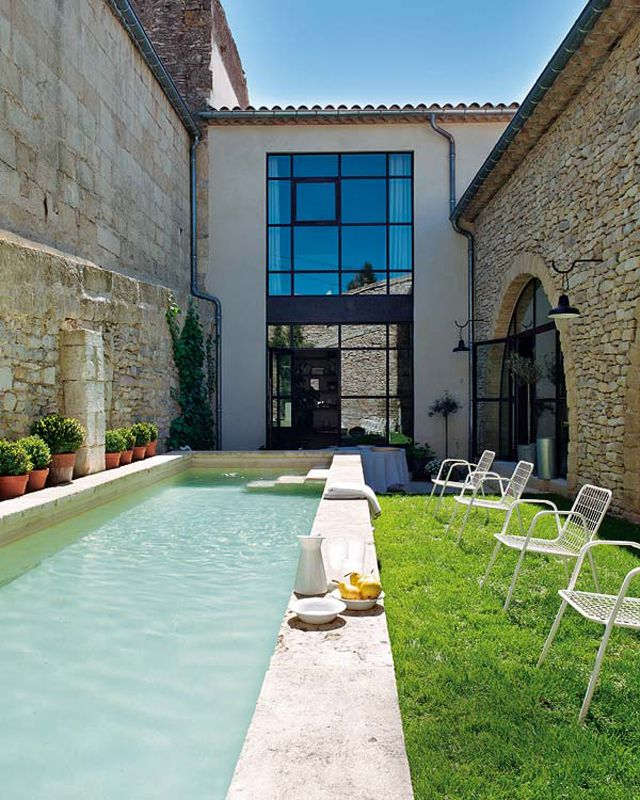 The old provençal oil mill conversion: the old stone basin turned into a family pool.