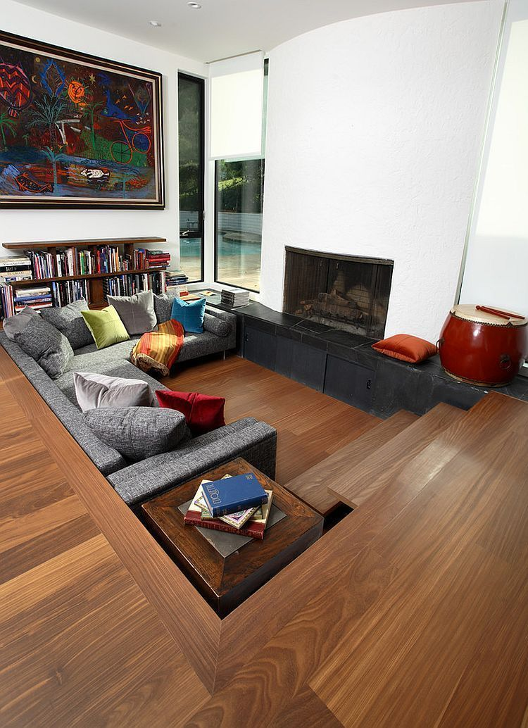 The space of the living room, while on a lower level than ...