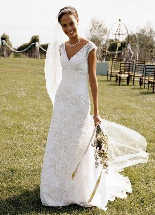 35f70be64e Amazon.com  David s Bridal Wedding Dress  Petite Allover Beaded Lace  Trumpet Gown Style 7T9612  Clothing