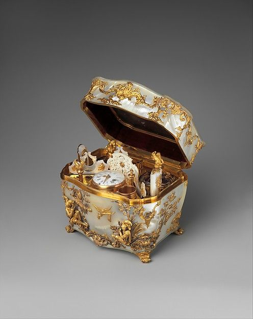 Nécessaire Date: 1745–50 Culture: German Medium: Mother-of-pearl, gold. Fitted with sewing and writing implements as well as a watch, this unmarked nécessaire shows delightful chinoiserie decoration in the Rococo style, echoing the work of the influential Munich designer François Cuvilliés (1695–1768). The Metropolitan Museum of Art
