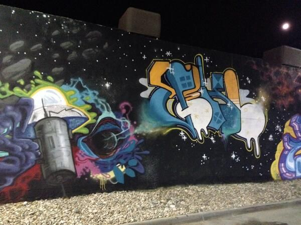 Space graffiti. A black hole sucking in this tag. Denver