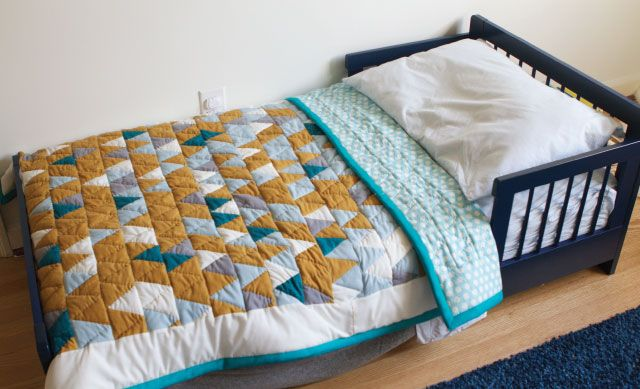 Hand-quilted triangle quilt for baby nursery or toddler