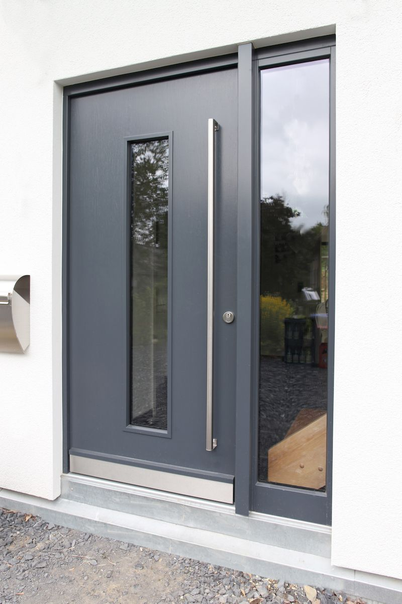 Modern full-leaf front door in anthracite with a wide side panel …