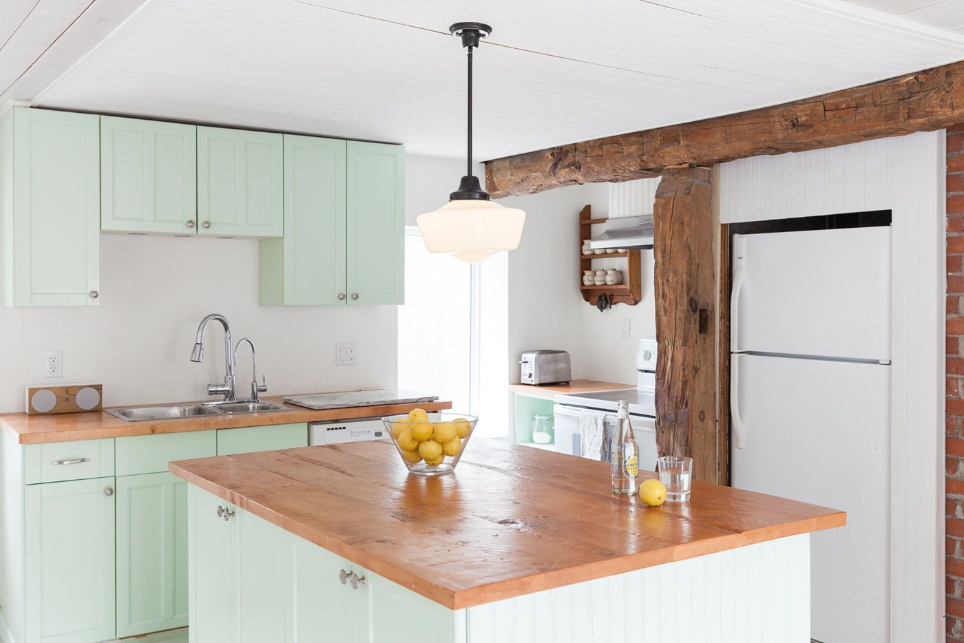This farmhouse kitchen with minty green cabinetry is the ...