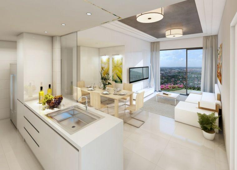 mobili pareti e pavimenti bianchi cucina open space con isola con lavello tavolo