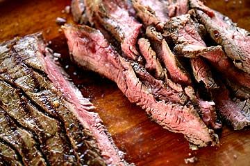 A melt in your mouth flank steak that is cooked quickly with a high heat.  The marinade of soy sauce, honey and garlic does the trick for this cut of meat.
