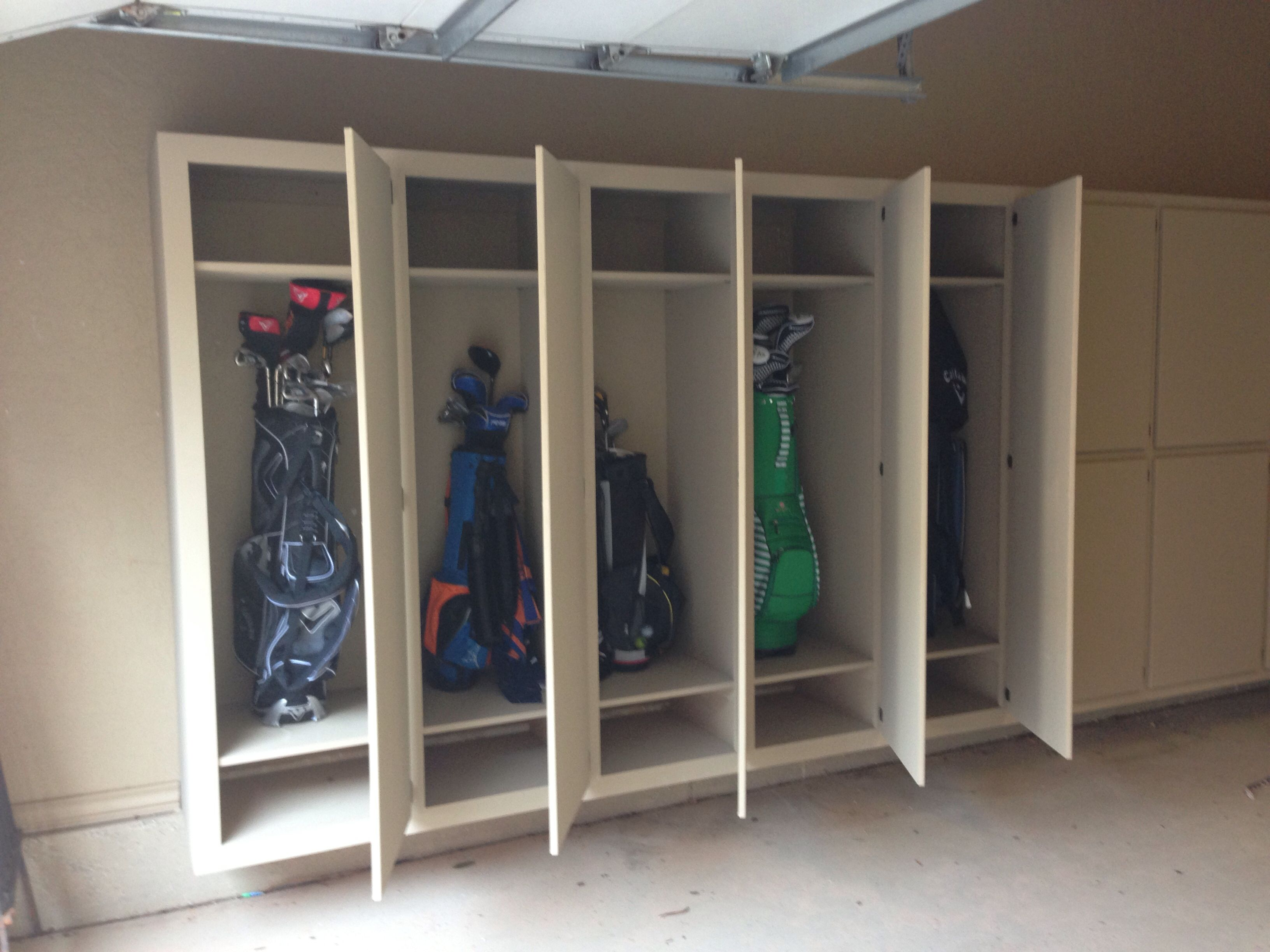 happy little golf clubs all tucked away in garage cabinets on new garage organization ideas on a budget a little imagination id=54176