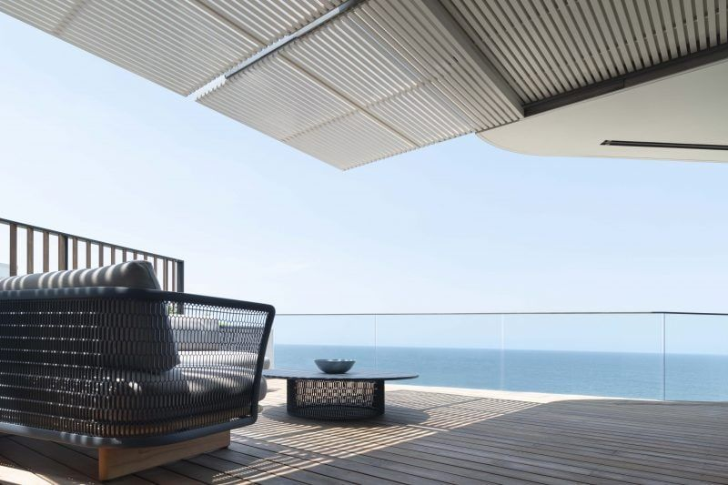 In the manner of the bowsprit of a majestic tall ship, the upper storeys of this residence reach out to the expansive horizon vista.  At the topmost level a prominent curved glass bow captures the scene spanning from Bronte Beach out to the headlands of world famous Bondi, and decks fit for a captain command breathtaking views. #panorama #view #beachhouse #oceanview #architecture #terrace #ocean #housebythesea #pacificviewpoint #luigirosselliarchitects #LRA