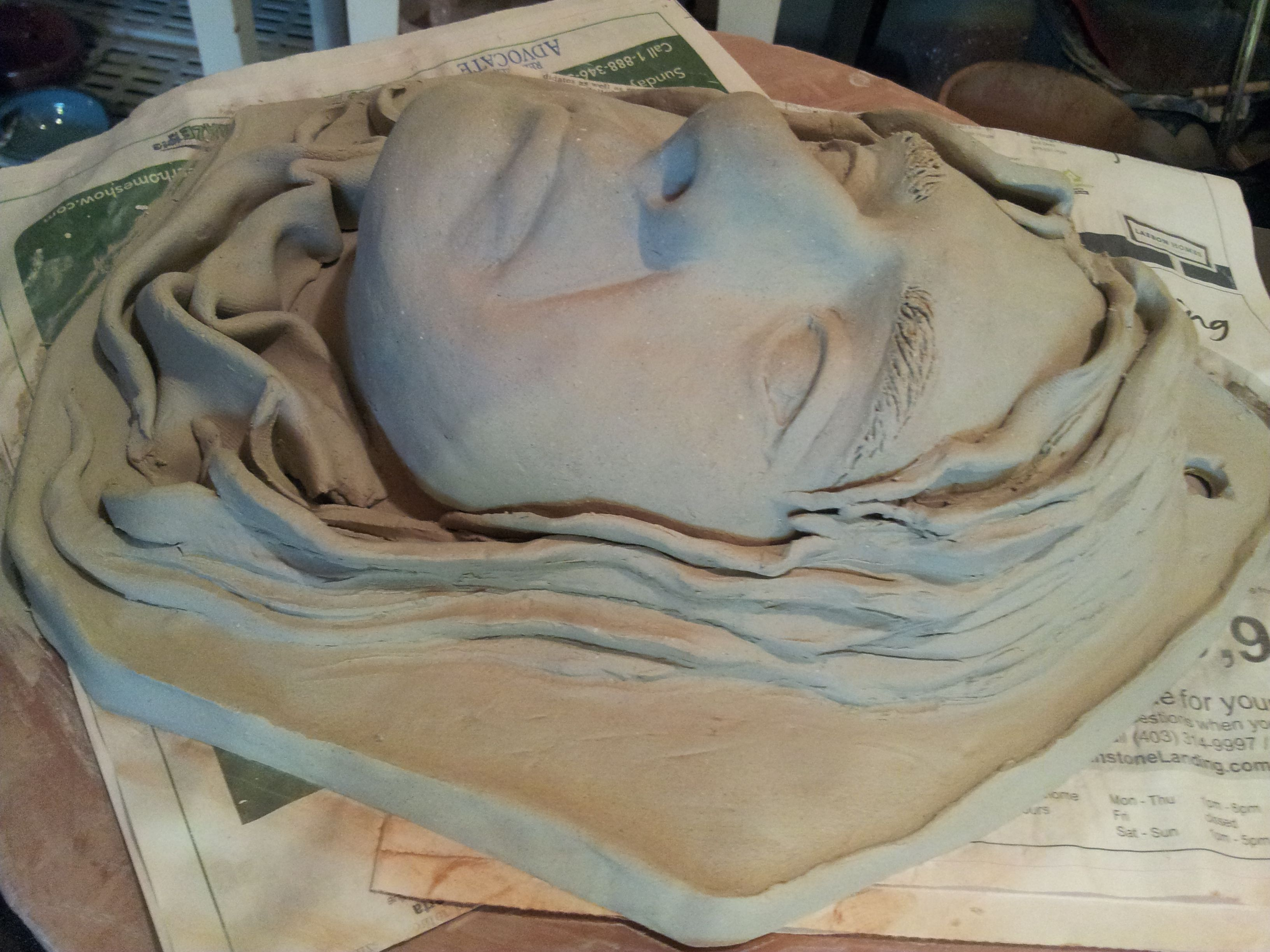 faces sculpted from paper clay....focusing on hair