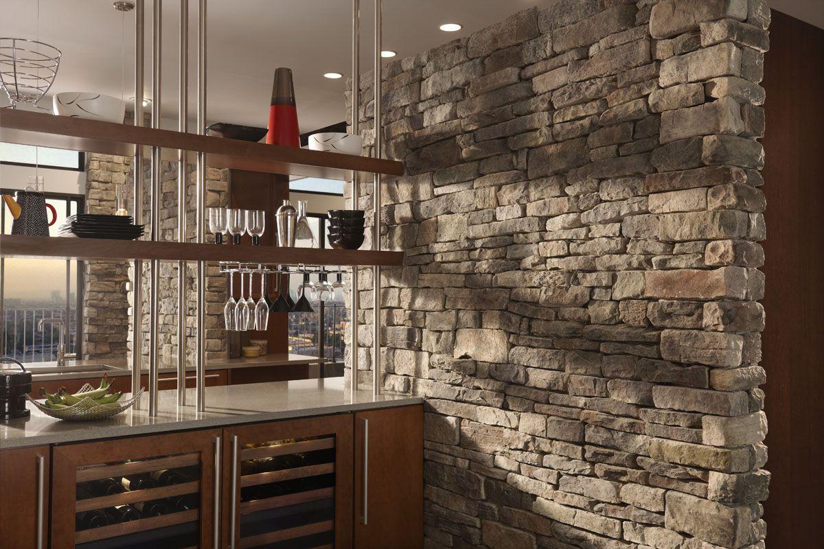 Stone veneer mimics the look of natural stone or brick for for Interior brick veneer cost
