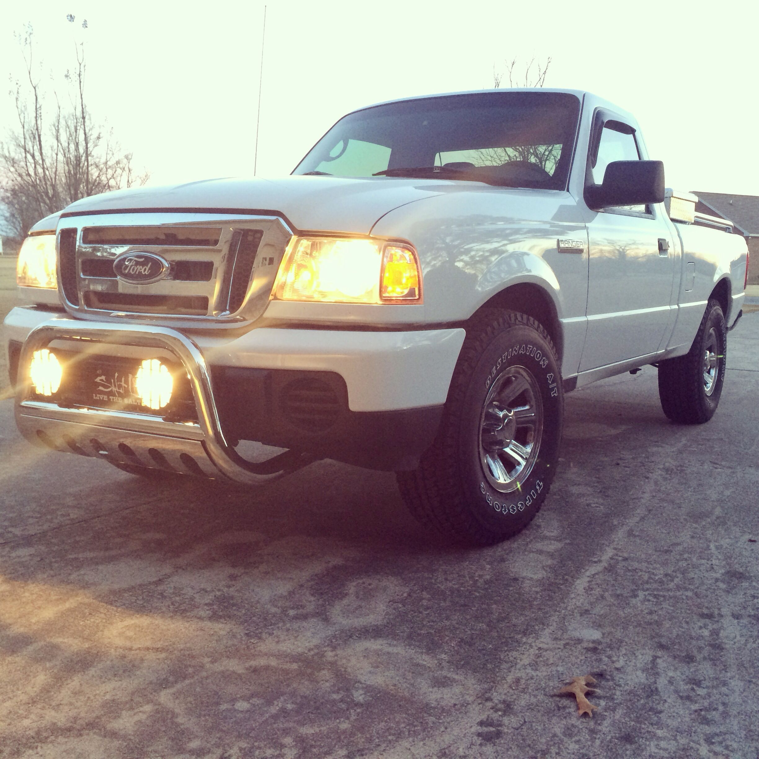 Ford ranger. No lift. 31' tires. Bullbar with lights. My