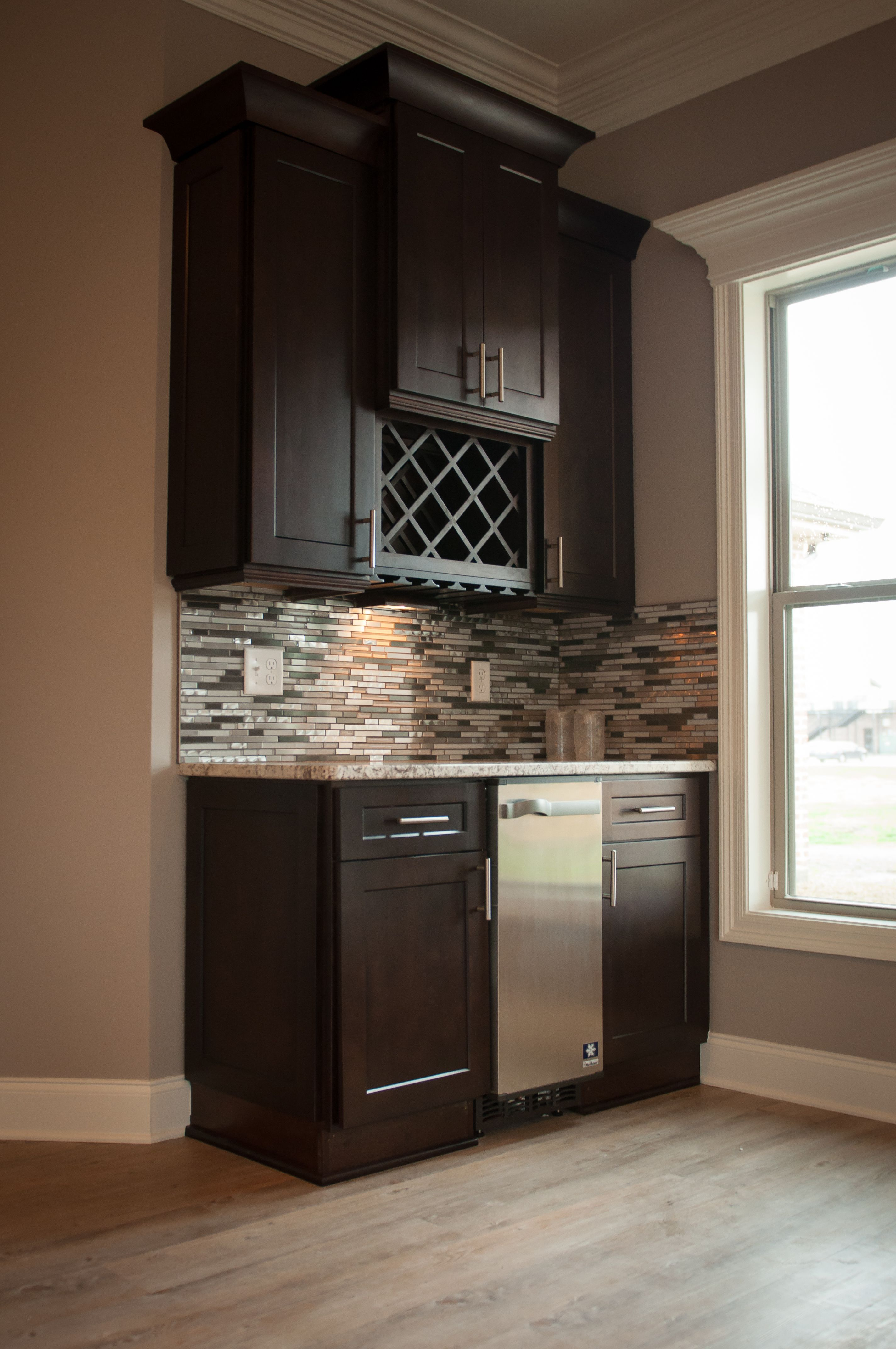 Gorgeous dark wood cabinets equipped with a handy wine rack ...