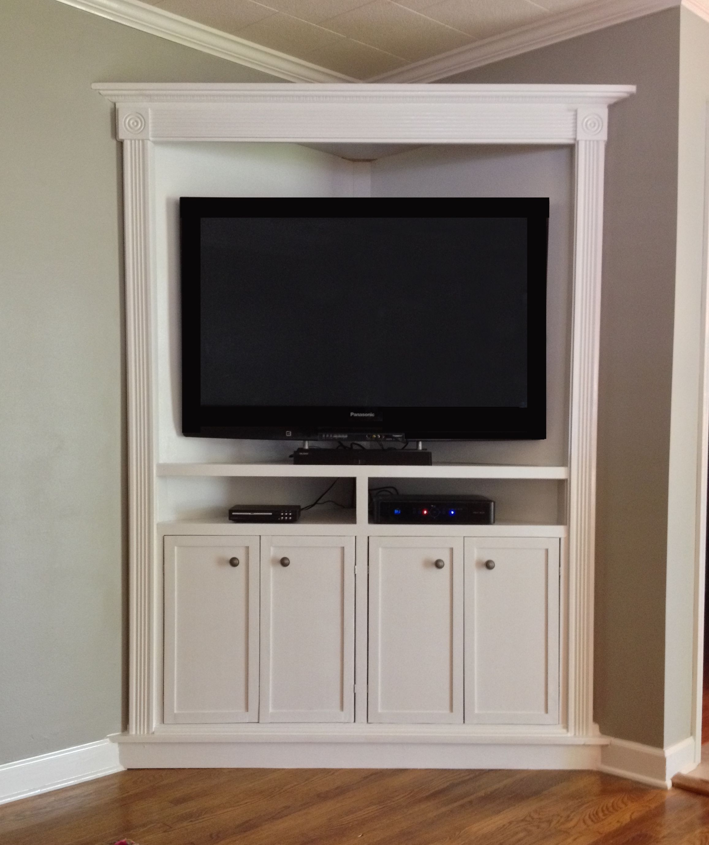 Hand crafted custom corner entertainment media cabinet by leveebreakdesigns custommade com