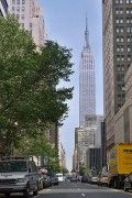 Street view of the Empire State Building, which is located on 34th Street between 5th Avenue and 6th Avenue, NYC