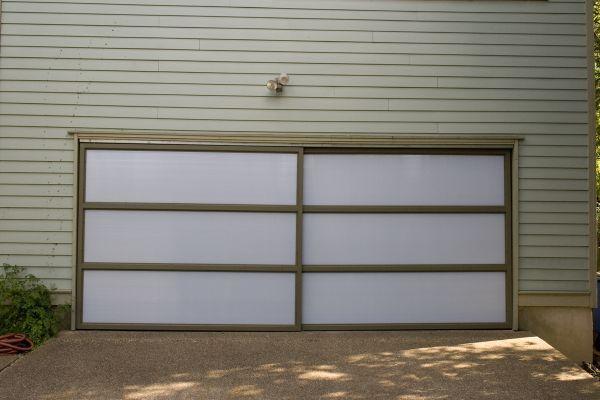 From Garage To Art Studio Garage Garage Doors Barn Door Garage