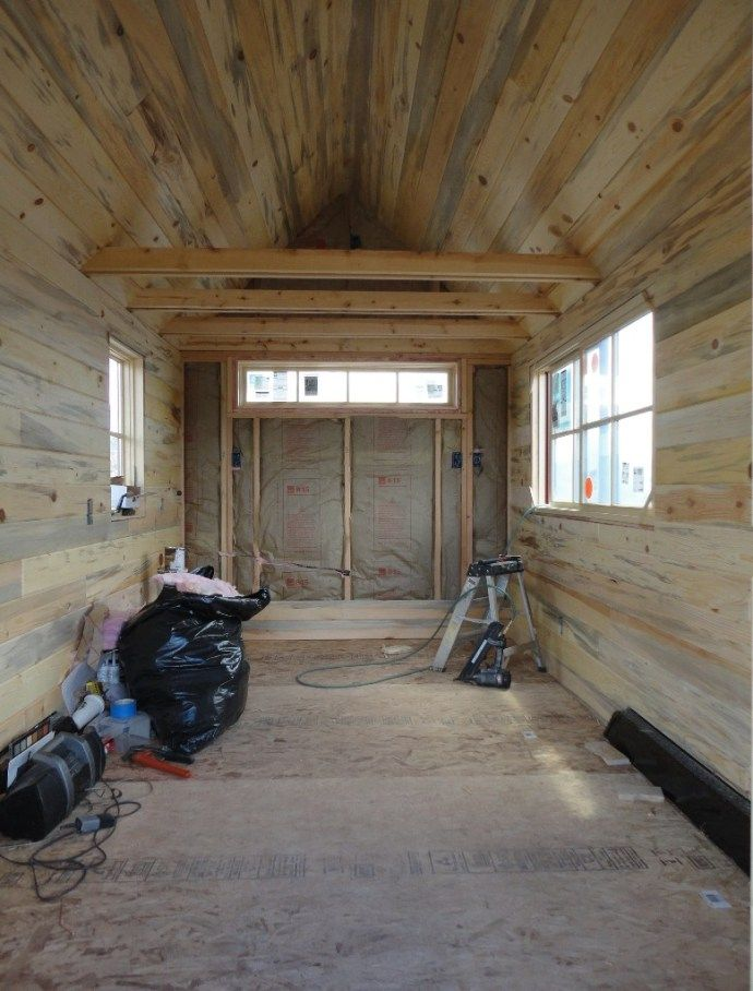 Tiny house interior paneling installed on the walls and ceilings blue stain beetle kill pine tongue and groove