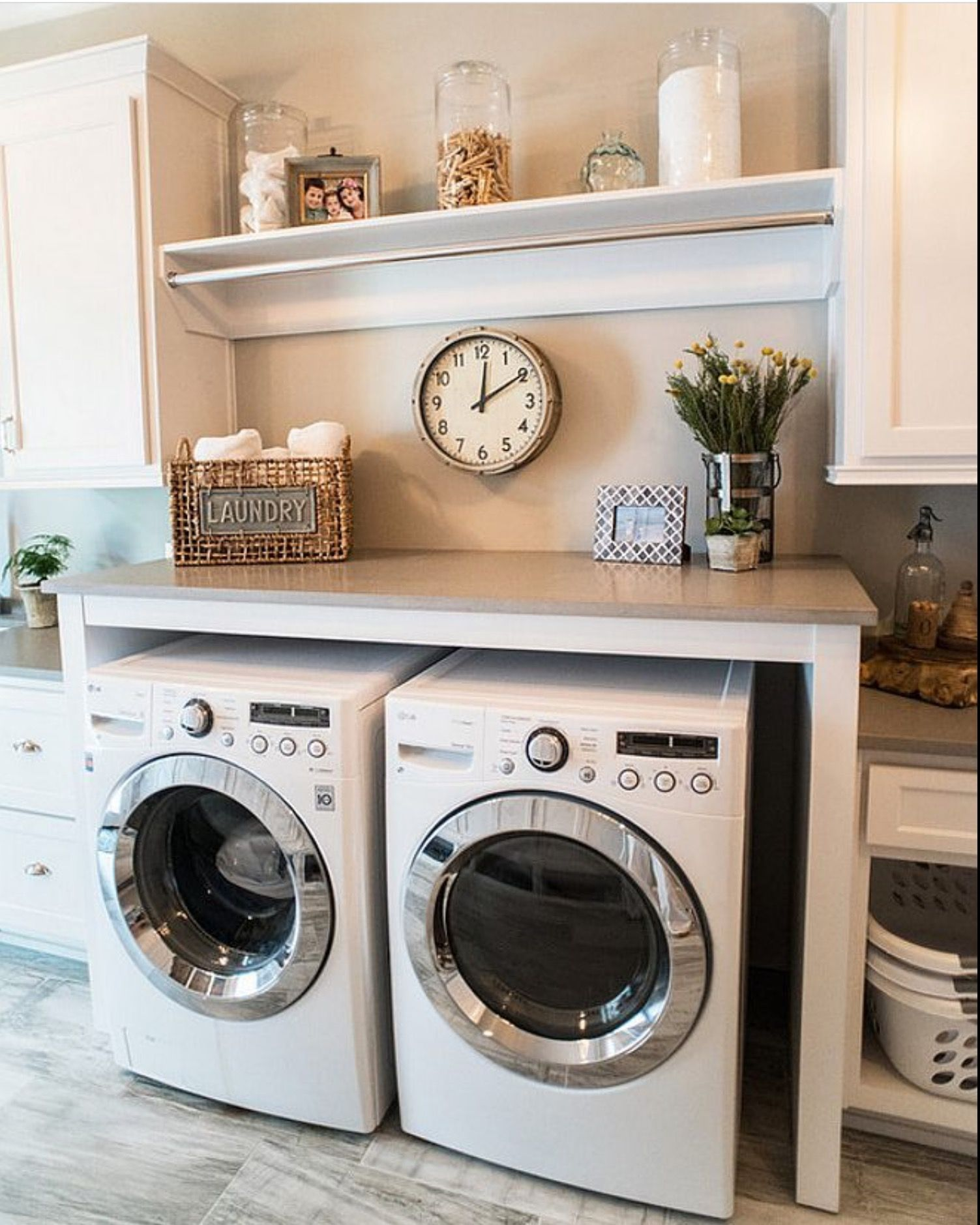 Laundry Room Combines White Cabinet With Gray Quartz Countertop And