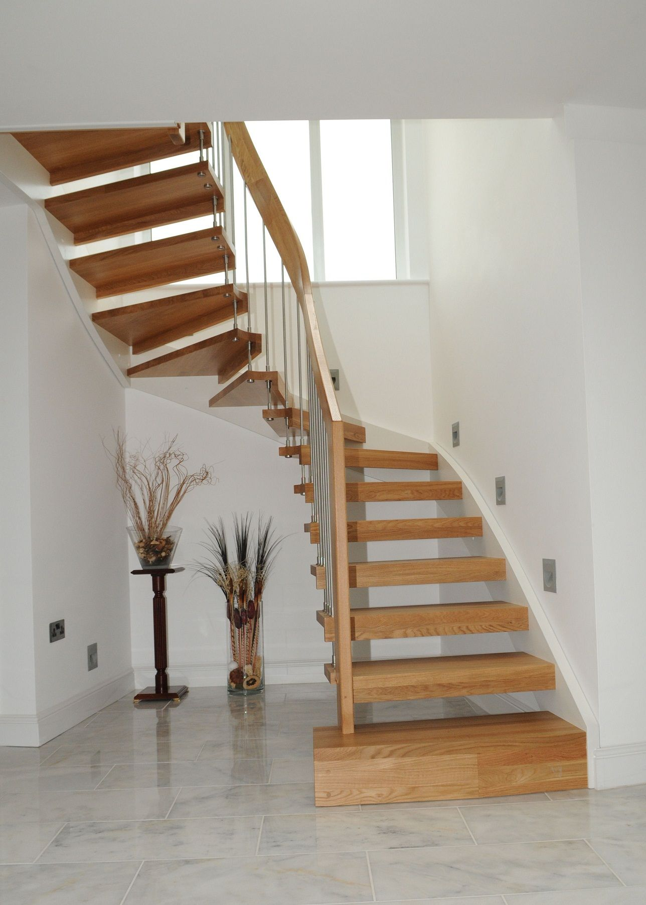 Enjoyable Curved Open Staircase With Wooden Steps Stairs As Well Three Gl Windows In White Room Modern Design