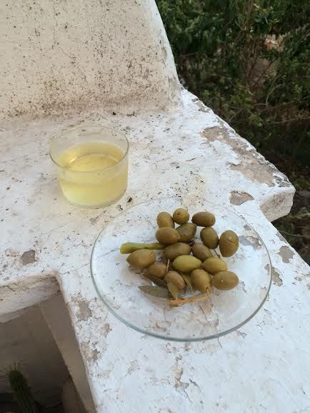 the classics @ home (cava, olives, good company, and invisible tableware).