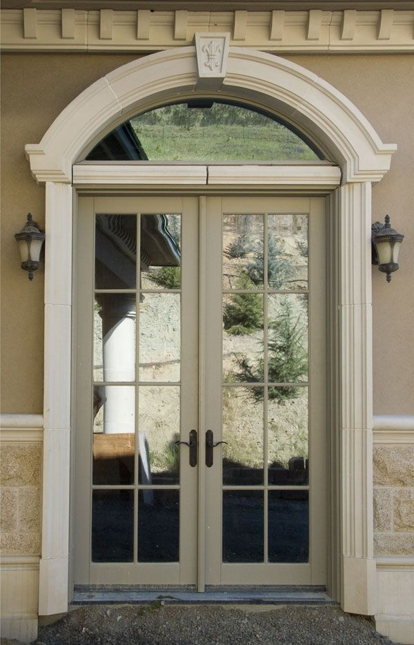 cast stone elliptical door surround with keystone and plinth