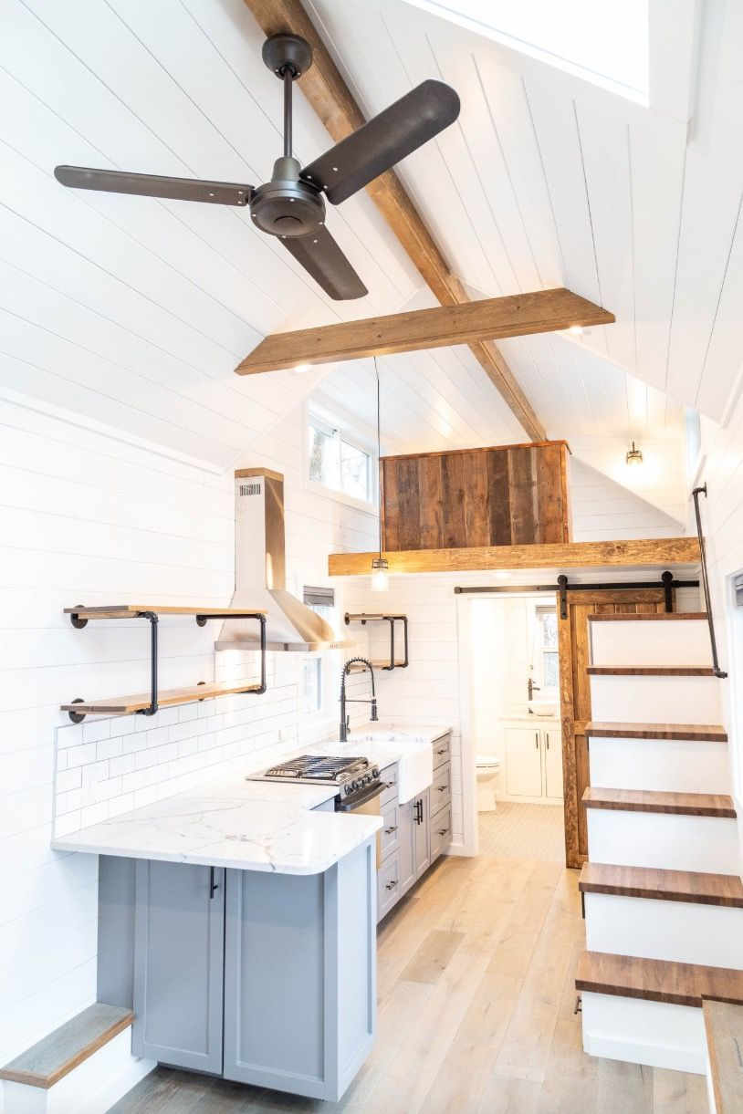 32-foot Farmhouse tiny house with a main-floor bedroom for $88k by Liberation Tiny Homes #tinyhousestorage
