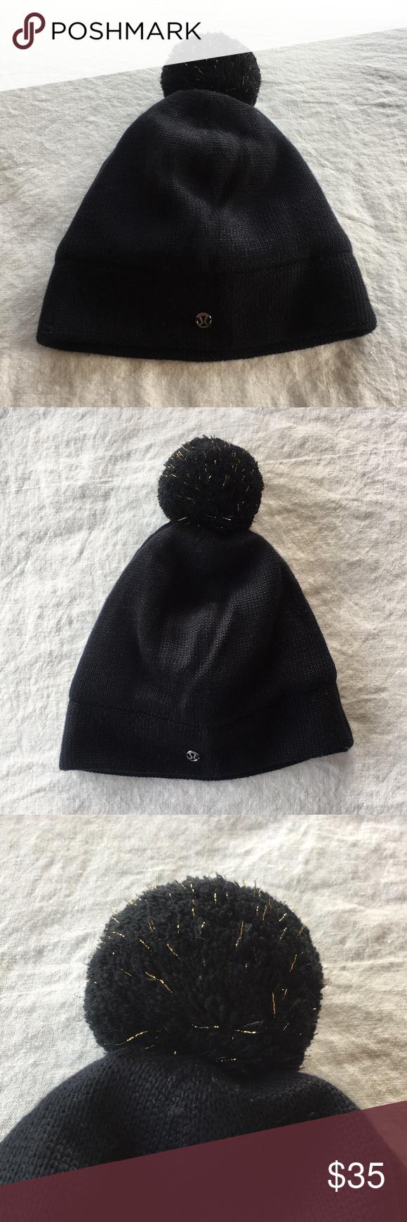 13d9eb772a6 Lululemon winter beanie hat with Pom Pom Lululemon Black winter beanie hat  with black gold sparkle Pom Pom. O S. Inside is insanely warm