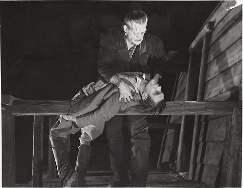 Frankenstein (1931). The Monster (Boris Karloff) ready to toss his maker (Colin Clive) off the windmill.