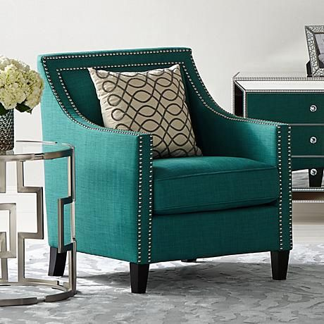 Stylish teal upholstery wraps beautifully around this modern style accent armchair.