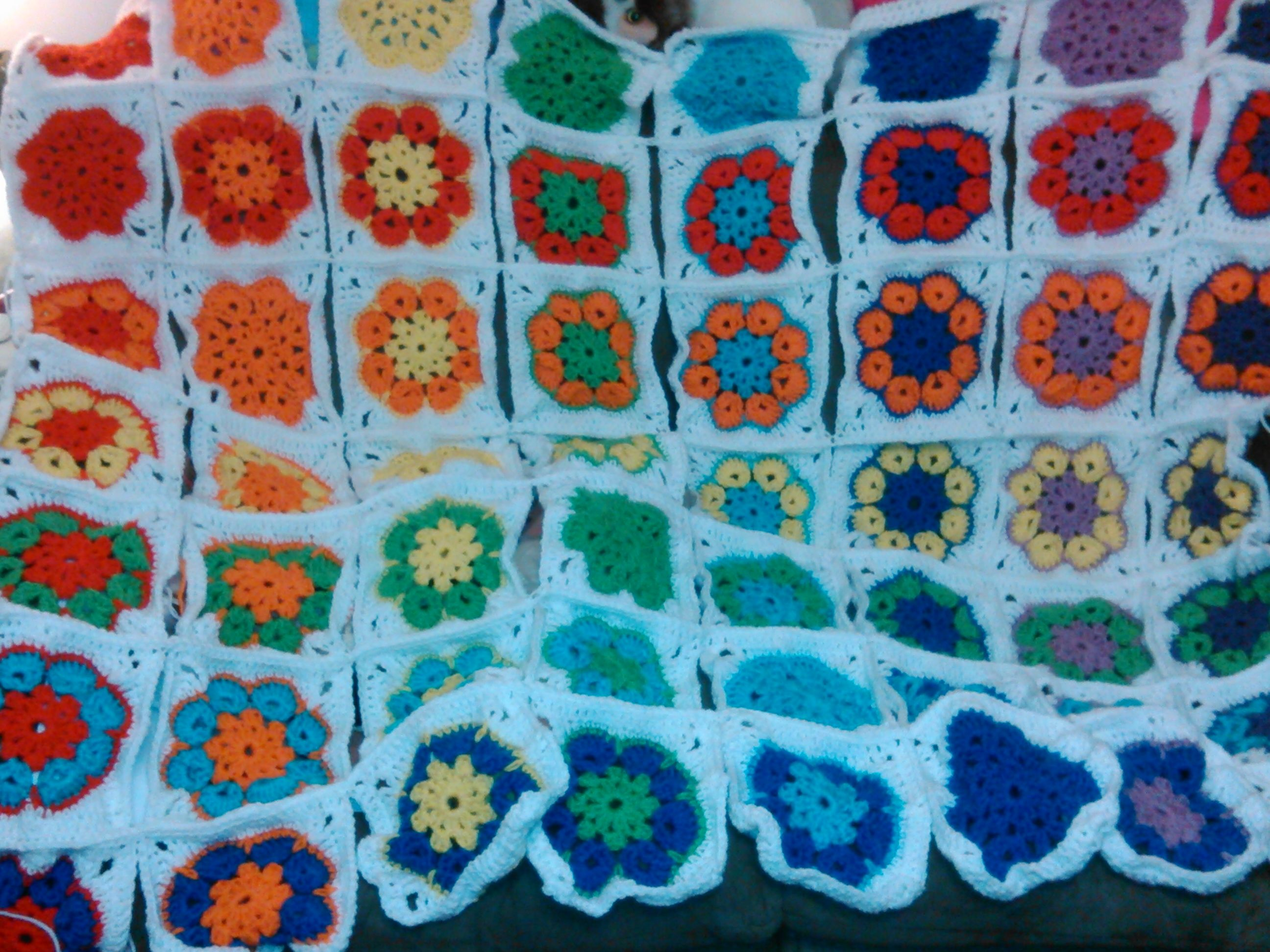 Work in progress rainbow granny square blanket will be about
