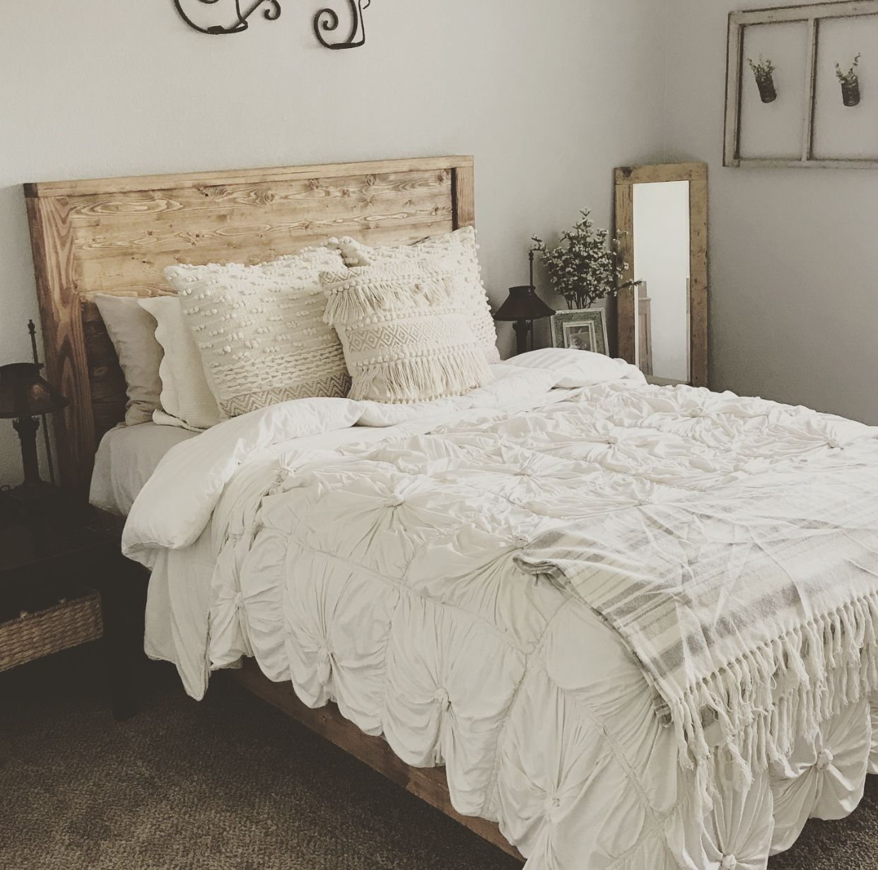 A beautifully crafted wooden headboard and bed frame. this