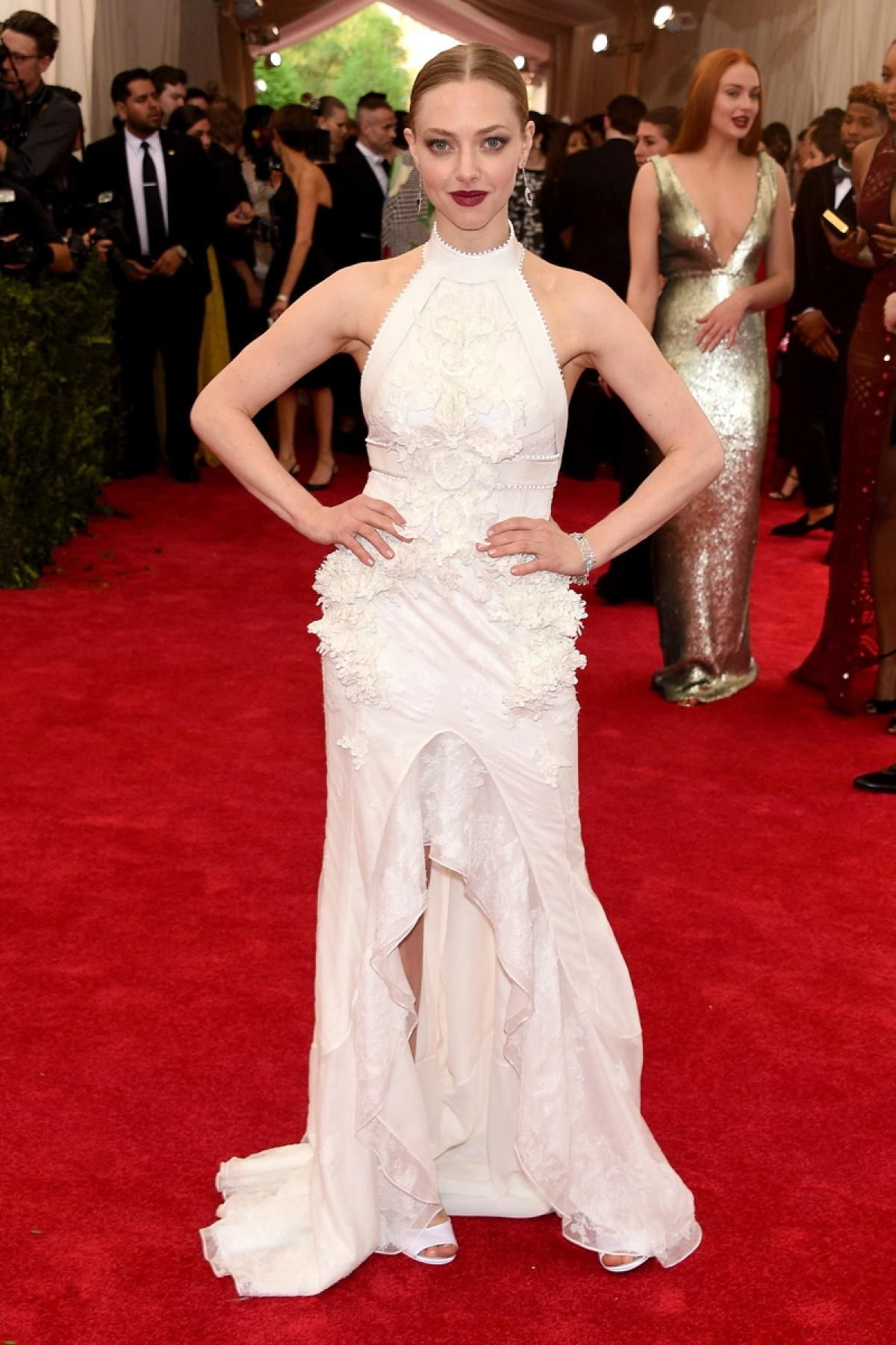 "Amanda Seyfried attends the ""China: Through The Looking Glass"" Costume Institute Benefit Gala at the Metropolitan Museum of Art in a simple white Givenchy gown on May 4, 2015."