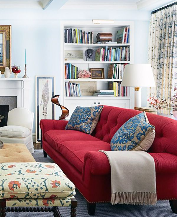 The anchor of any living room, sofas are central for both giving everyone a seat during a movie marathon or game night, while also tying together your space's look. red couch white living room | Red sofa living room, Red ...