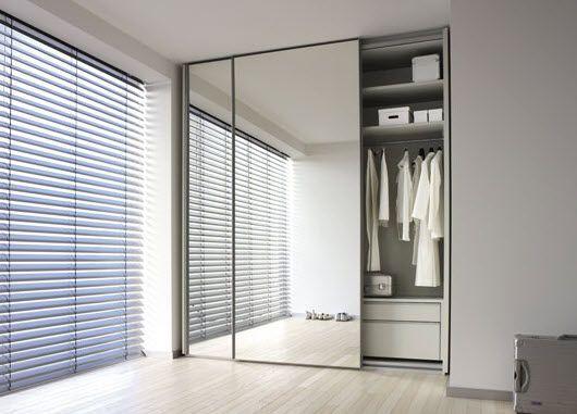 Puerta corredera en armario con espejo puertas for Puertas con espejo