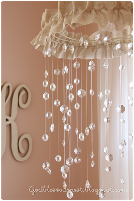 too cute! DIY Crystal Baby Mobile tutorial: spray painted Wire Wreath frame, Chandelier crystals, fishing line, fabric or other trim to hide wreath frame, sheet rock anchor w/ screw for hanging & lots of time!! @Sarah Chintomby Chintomby Chintomby Wilson @Meghan Krane Krane Krane Gillis