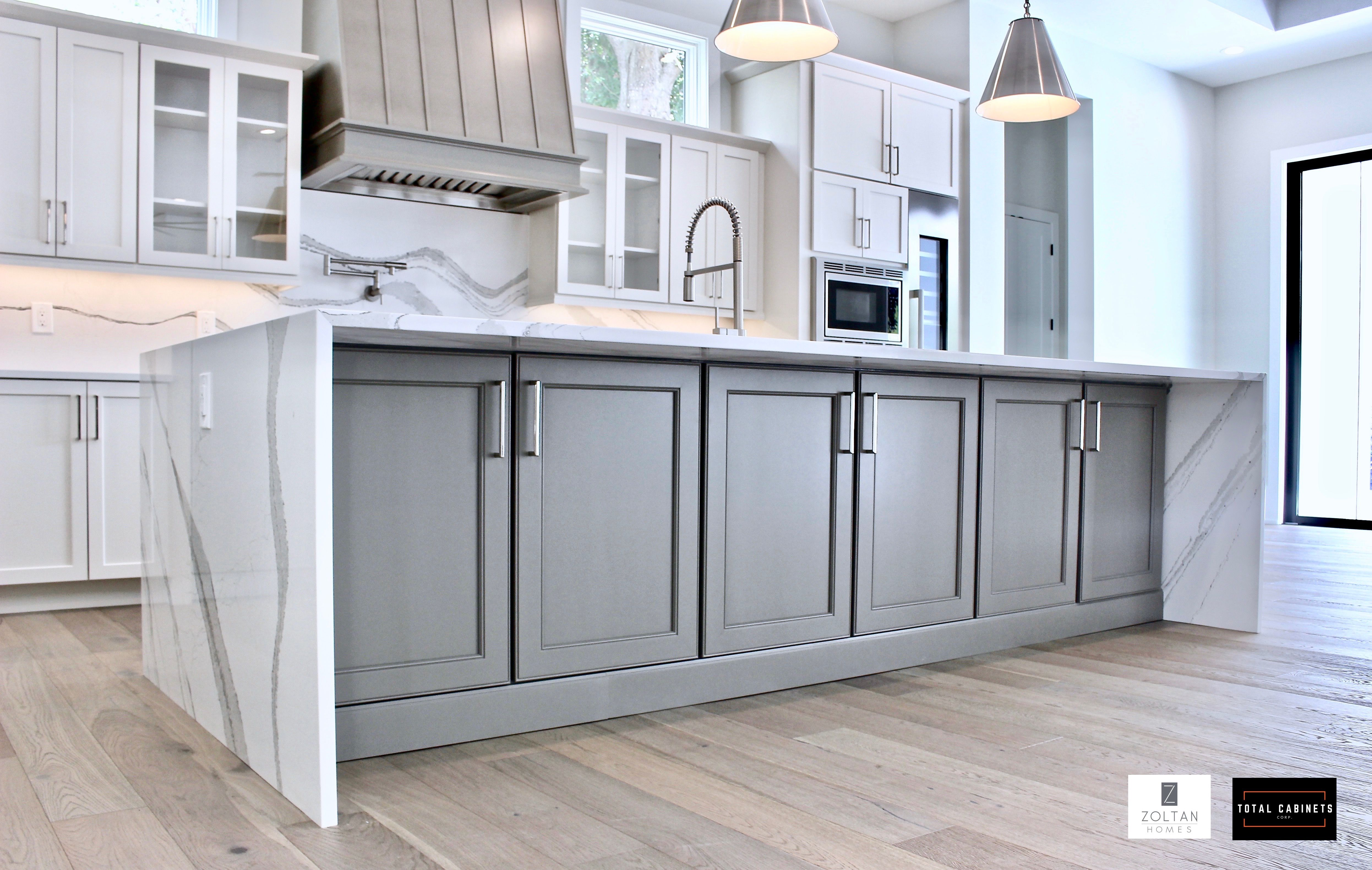 Transitional Kitchen With Waterfall Island White And Gray Shaker Cabinets Combined With Edgy Black Kitchen Island Kitchen Island Cabinets Grey Kitchen Island