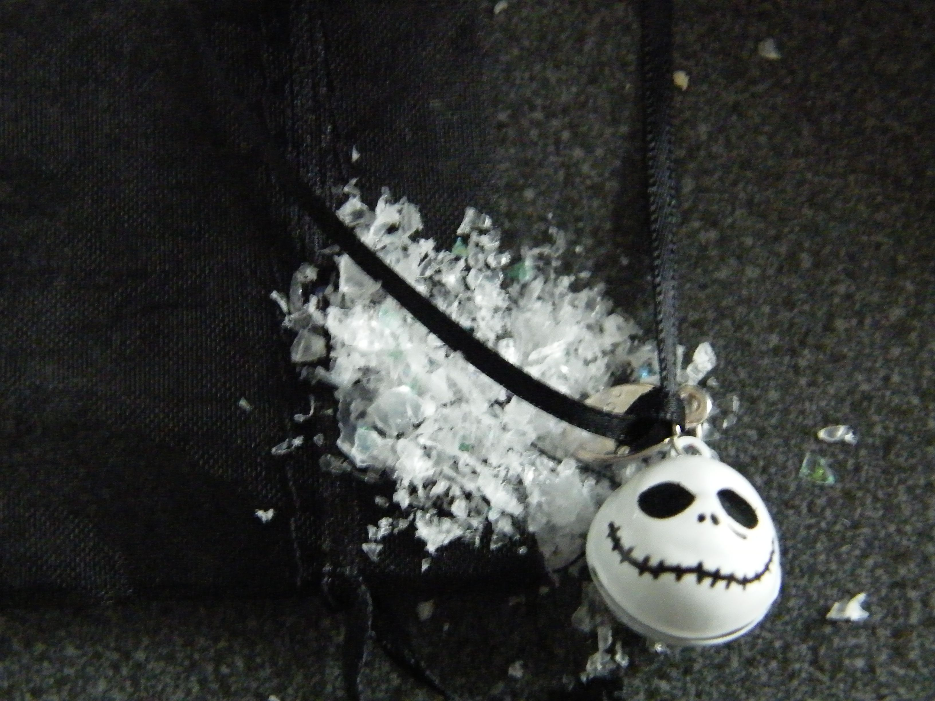 jack skellington bell on black ribbon.