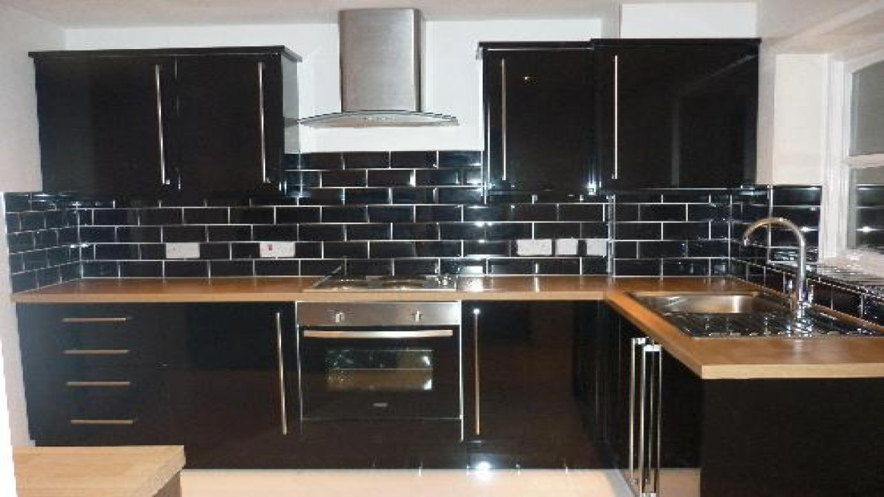 black kitchen tiles 12 Subway Tile Backsplash Design Ideas + Installation Tips