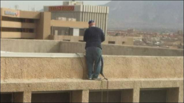 Man On A Ledge Worries Downtown Workers Window Cleaner Window Cleaning Companies Washing Windows