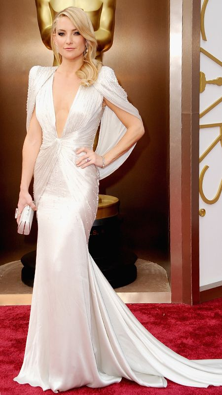 Kate Hudson: Atelier Versace, 2014 -   The blonde bombshell graced the red carpet at the 2014 Academy Awards in a glittery plunging Atelier Versace creation, complete with a cape and Neil Lane jewelry.