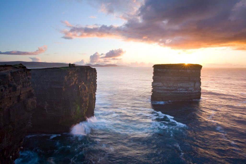 Downpatrick Head on the west coast of Ireland is an ancient pilgrim destination and named after St. Patrick as he founded a church on the site.
